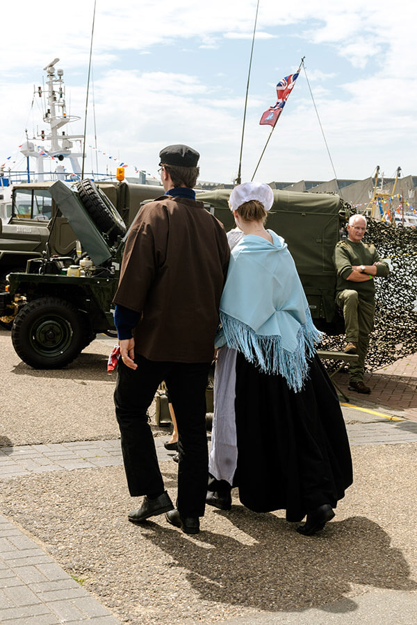 Couple in traditional Scheveningse klederdracht on Vlaggetjesdag in Scheveningen.