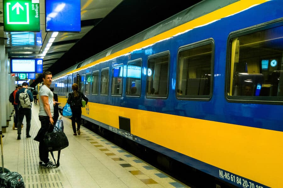 Photo of a train departing from Schiphol Airport to Amsterdam at the Schiphol Airport train station.