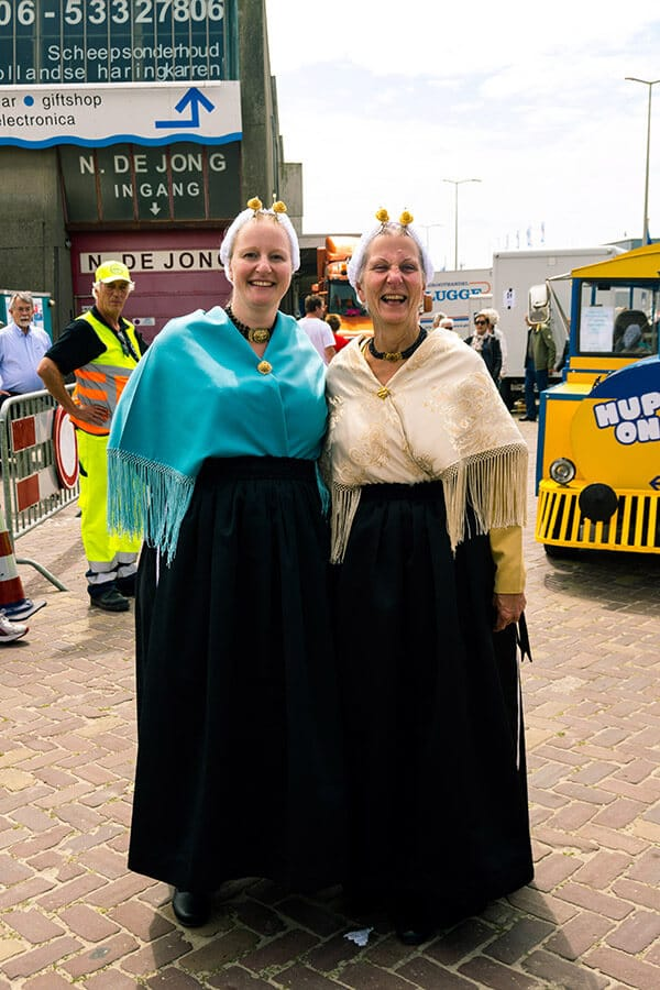 Women wearing Scheveningse klederdracht, traditional clothes worn in Scheveningen, on Vlaggetjesdag in Scheveningen.