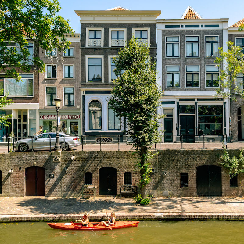 People kayaking in Utrecht, one of the best off the beaten path things to do in Utrecht, the Netherlands. #utrecht #netherlands