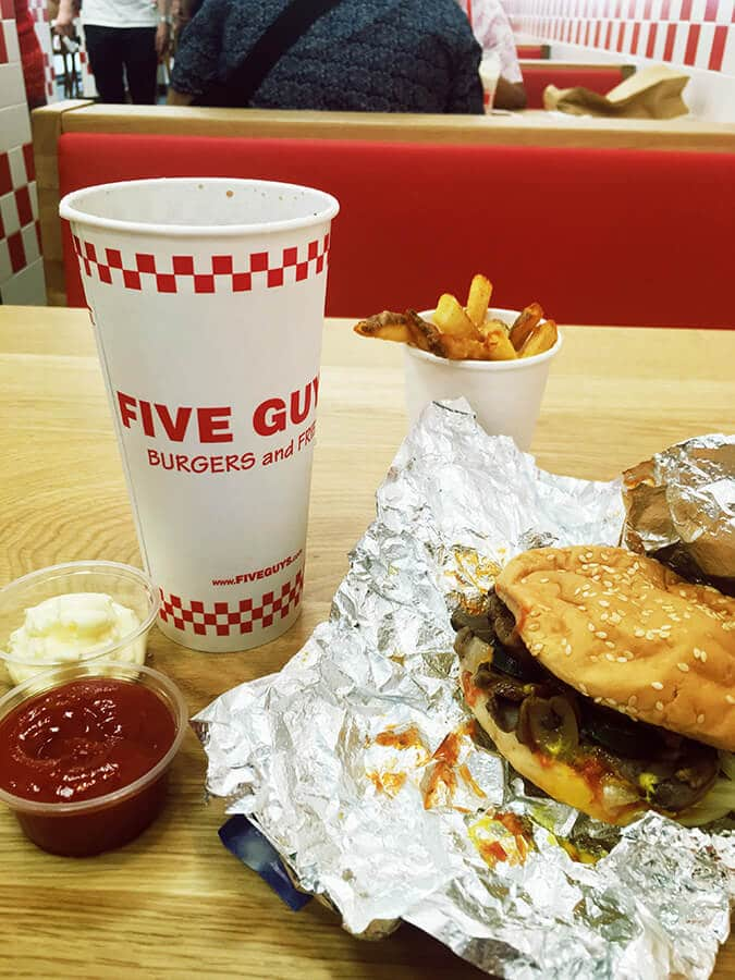 Hamburger and fries at Five Guys in the Hague, the Netherlands.  This American chain has good American food in the Hague. #travel #food #americana