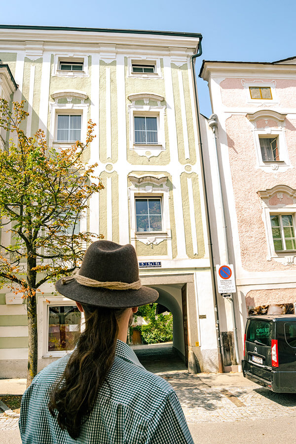 Man admiring the beautiful architecture of Enns, Austria.