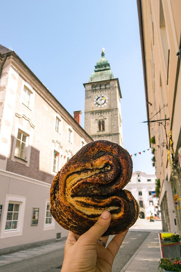 Delicious poppy seed pastry with a view of the historic Stadtturm in Enns, Austria. #travel #food #austria