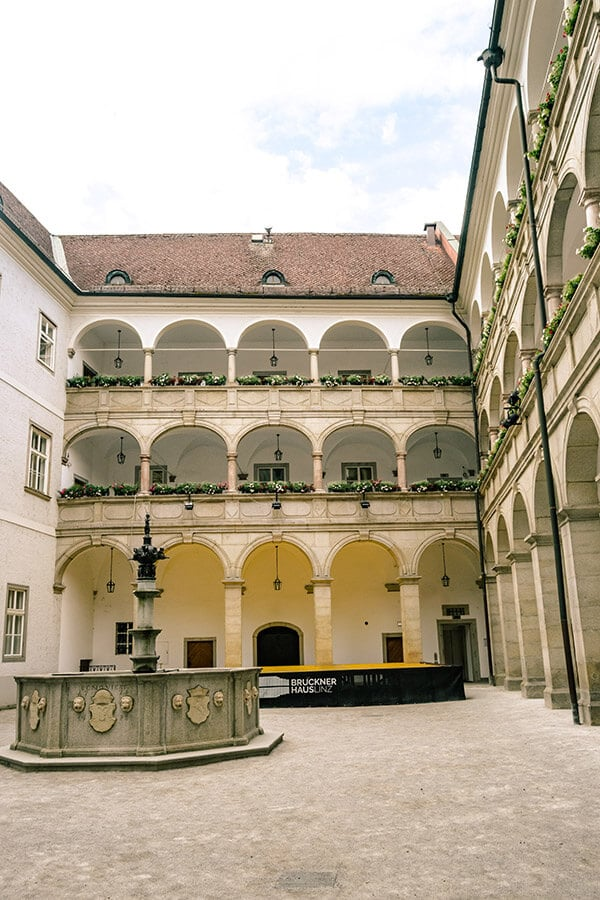 Courtyard of the Landhaus Brücke, one of the most historic buildings in Linz Austria. If you are visiting Linz, walking through the city center is one of the best things to do in Linz! #linz #austria