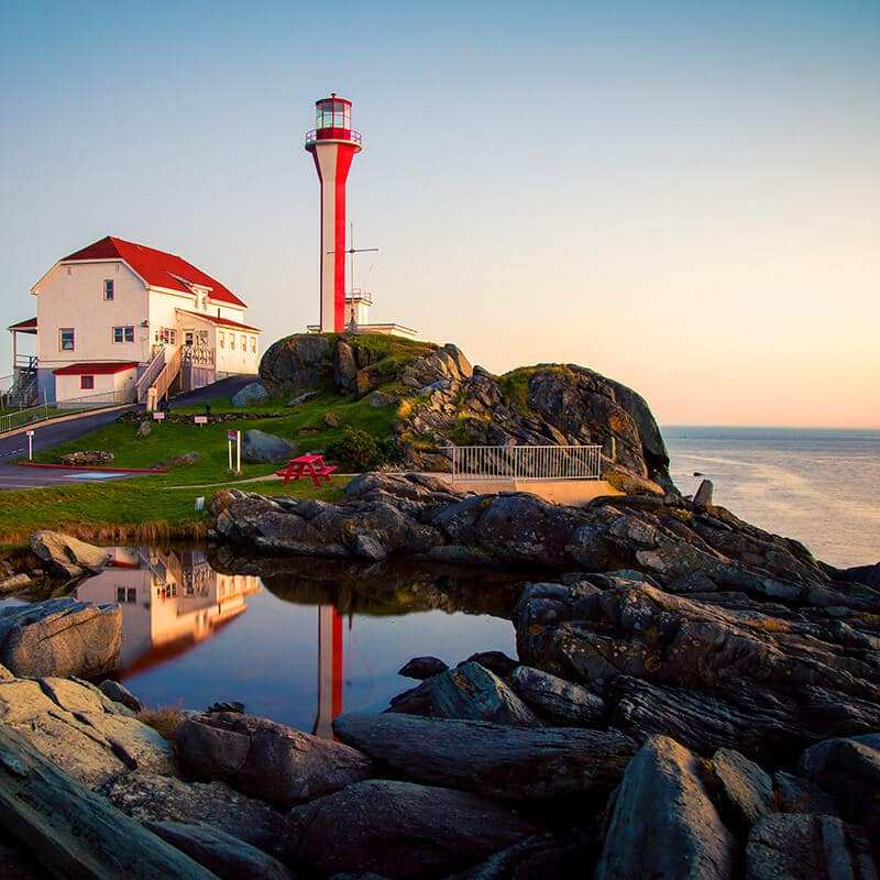 Beautiful lighthouse in Nova Scotia.  Read what you need to know before your trip to Nova Scotia with tips for the best time to visit Nova Scotia! #canada #novascotia #travel