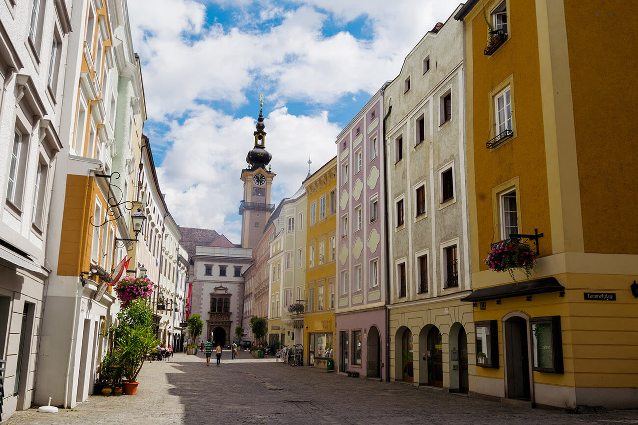 Beautiful street scene of historic city center of Linz, Austria with pastel buildings.