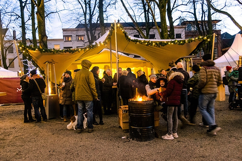Revellers enjoying the Royal Christmas Market in the Hague, one of the best Christmas markets in the Netherlands. #travel #holland #kerst
