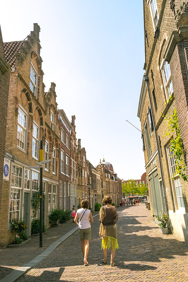 Beautiful street in Dordrecht full of houses from the Golden Age. Dordrecht is the oldest city in Holland and the perfect day trip from Rotterdam. #travel #holland #netherlands #nederland