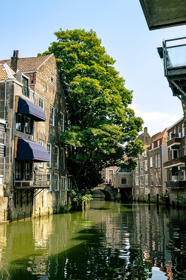 Dordrecht, one of the oldest and most beautiful cities in Holland. This stunning city known as the Venice of Holland is full of beautiful canals! #travel #holland #dordrecht