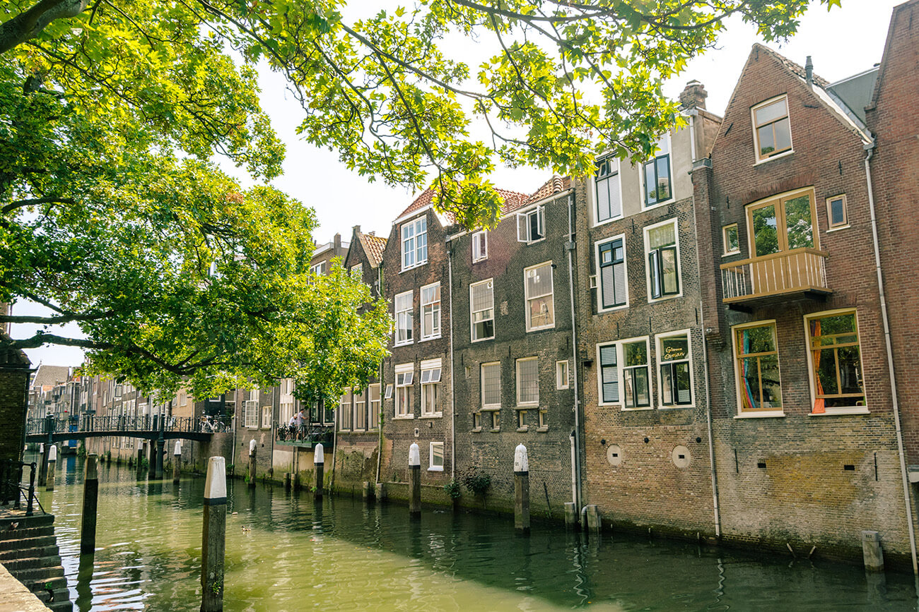 Beautiful warehouses along the canal in Dordrecht, the oldest city in Holland.  This beautiful day trip from Rotterdam is very romantic and full of great things to do! #travel #dordrecht #holland #nederland