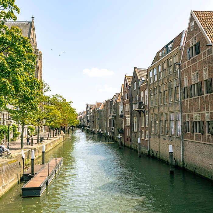 Beautiful warehouses in Dordrecht, the Venice of Holland. Be sure to include this beautiful city in your week in the Netherlands! #travel #netherlands #holland