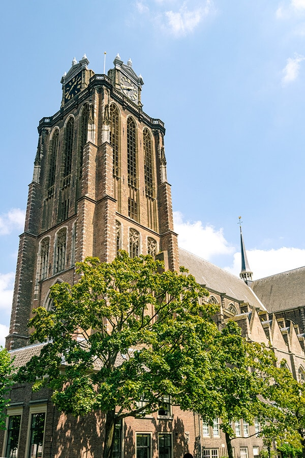 Beautiful historic medieval church in Dordrecht, Holland.  This stunning church with a leaning tower has a great view of the historic city center. #travel #holland #dordrecht #nederland