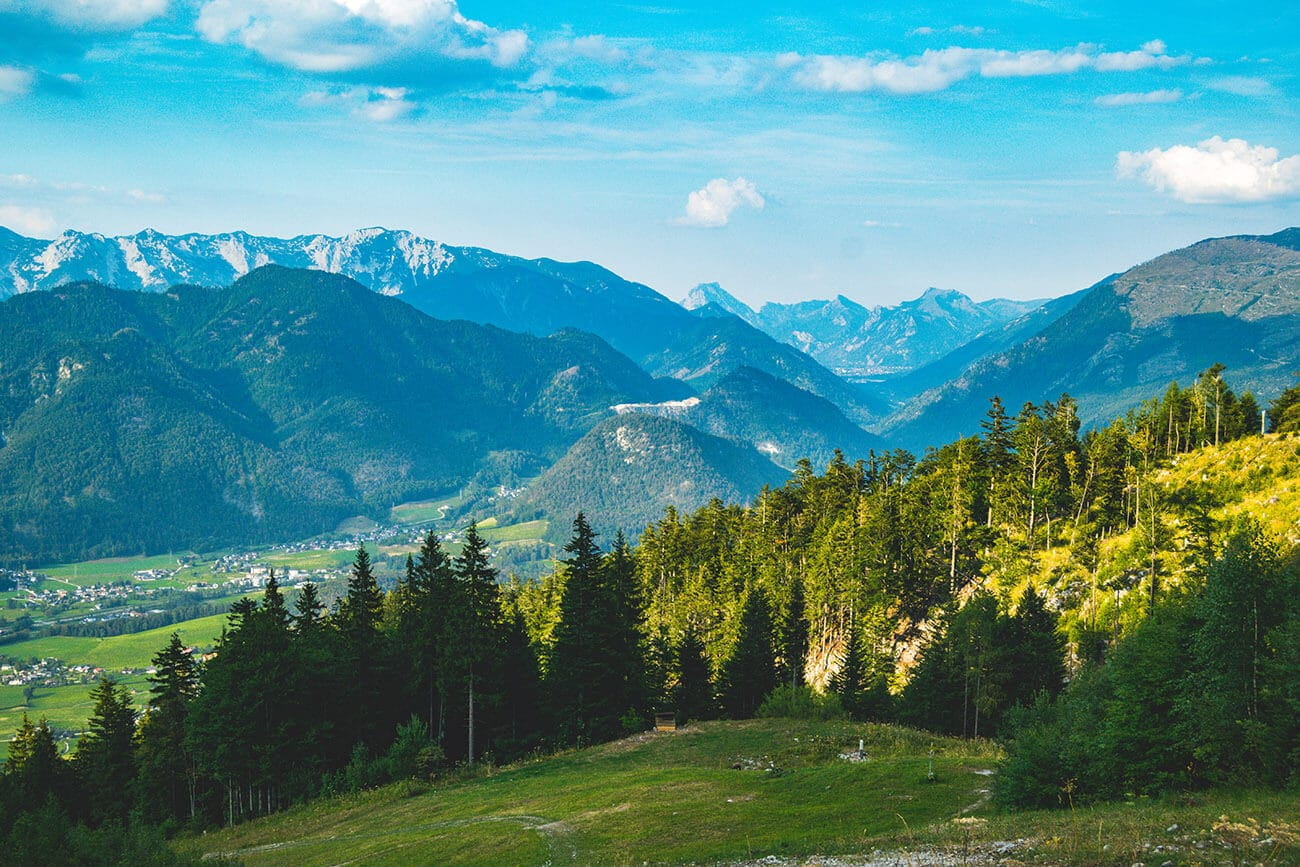 Beautiful view of Austrian mountains. Read about how to visit Austria on a budget with cost cutting tips for reducing your travel budget in Austria.
