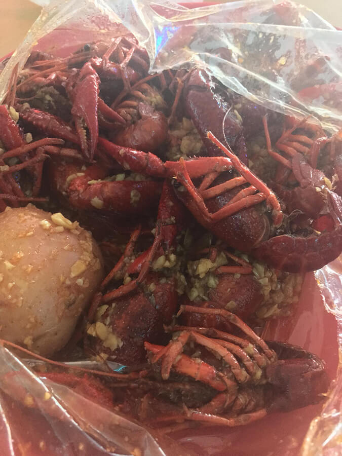 Viet-Cajun Crawfish in Houston, Texas. This unique food in Houston is something that you must try while in Texas. #texas #houston #food #travel