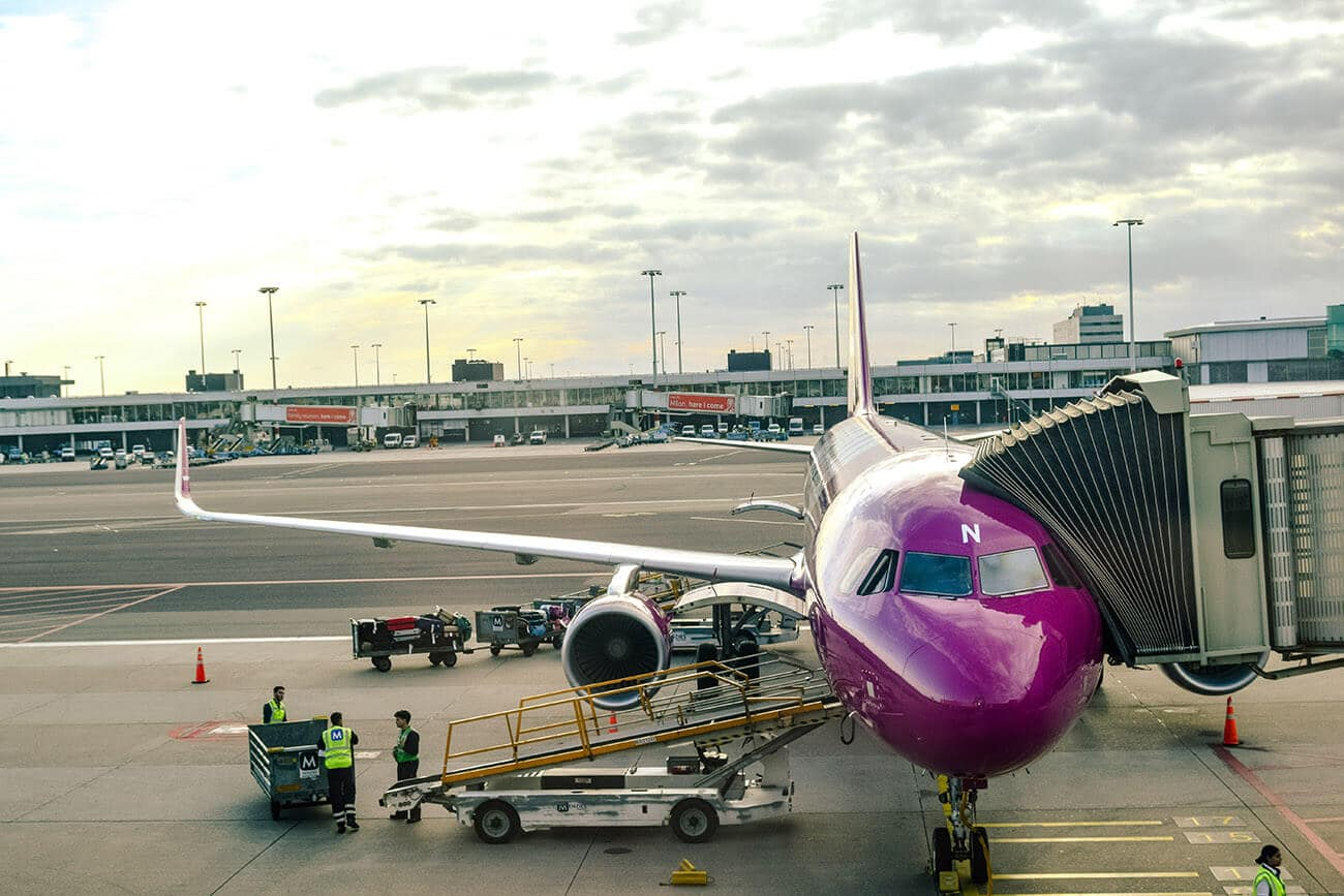 WOW air plane being loaded at JFK airport. This budget Icelandic airline is a popular choice for cheap flights to Iceland.