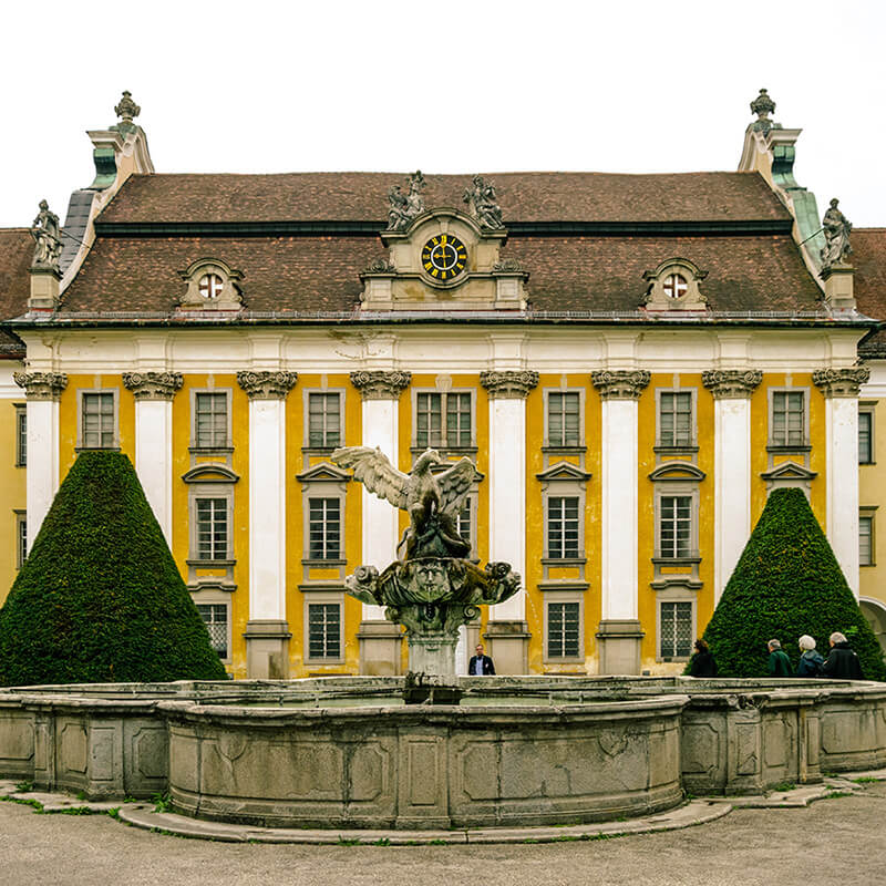 The beautiful courtyard of St. Florian Monastery featuring the fountain of the eagle.