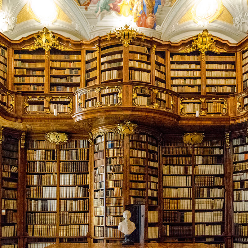 The beautiful baroque library of St. Florian Monastery in Austria. Although most people head to Melk Abbey, this beautiful monastery has none of the crowds and lower admission! #travel #austria #libraries #library #baroque
