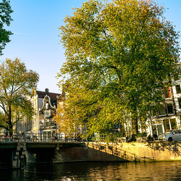 Beautiful scene in Amsterdam in fall. If you're visiting the Netherlands, you need to see the Netherlands beyond Amsterdam. Click for the perfect itinerary! #amsterdam #holland #netherlands #travel