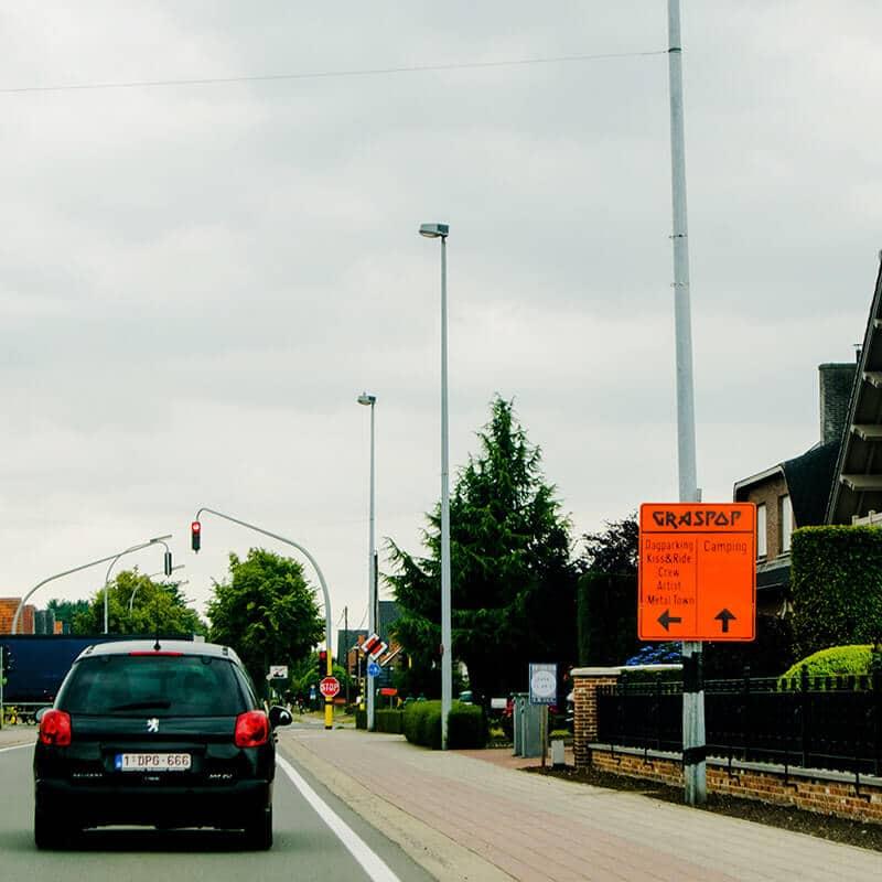 Sign in Dessel, Belgium showing the way to Graspop Metal Meeting