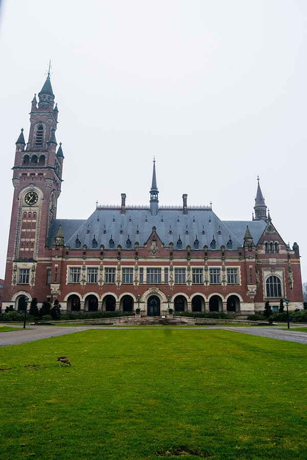 Peace Palace in the Hague seen from the sidewalk.  This self-guided biking tour of the Hague covers the major highlights of the Hague for first time visitors interested in politics! #travel #netherlands #holland #hague #denhaag