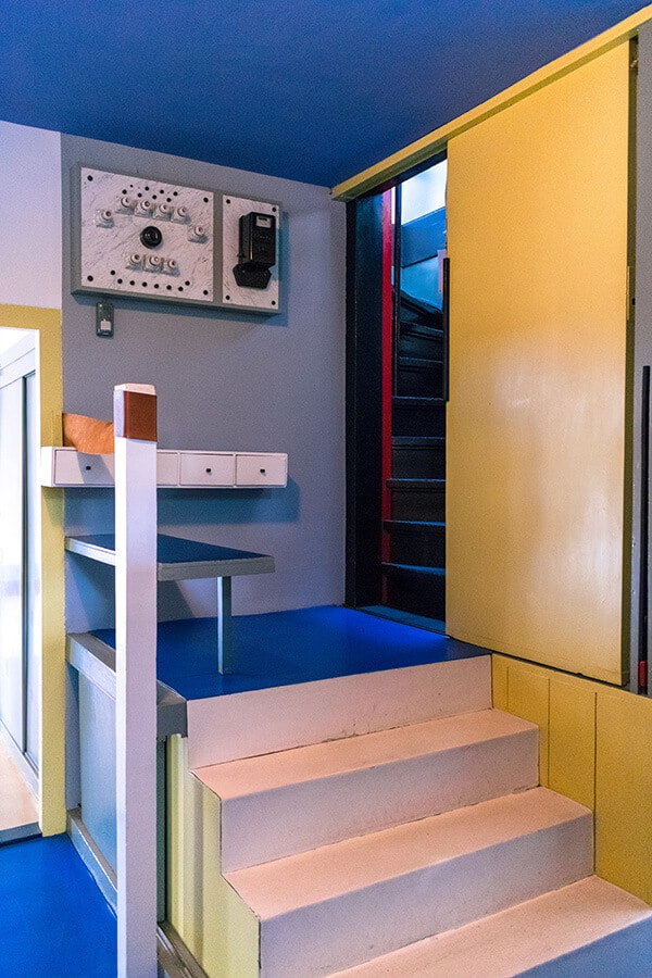 The entrance to the staircase of the Rietveld schröderhuis.  The interior of this house is an icon of De Stijl due to its use of primary colors! #design #interiordesign #architecture #destijl