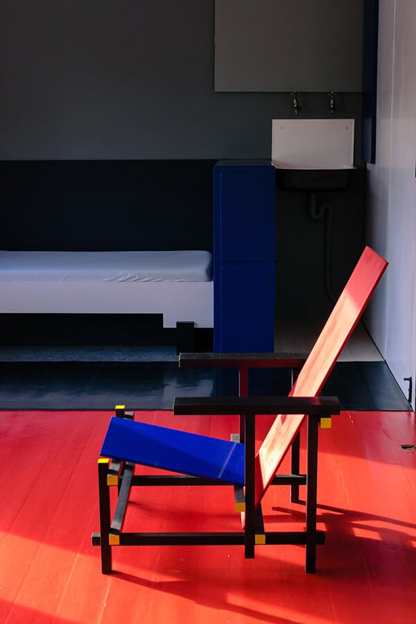 The Red and Blue chair in the Rietveld Schröderhuis.  This iconic piece of furniture in De Stijl was designed by Rietveld himself. #destijl #interiordesign #furniture #design