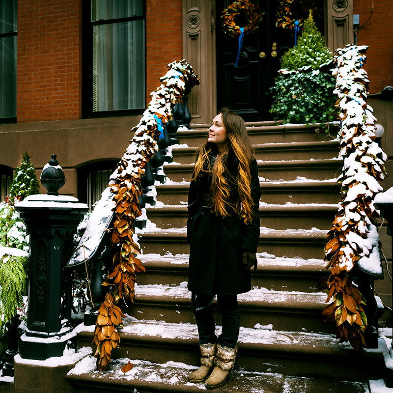 Girl enjoying winter in Greenwich Village, one of the most beautiful places to visit in New York City during winter! #travel #NewYork #NYC