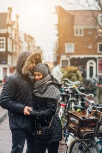 Couple enjoying shopping in the Nine Streets, one of the most romantic things to do in Amsterdam. Read your perfect couple's guide to Amsterdam.