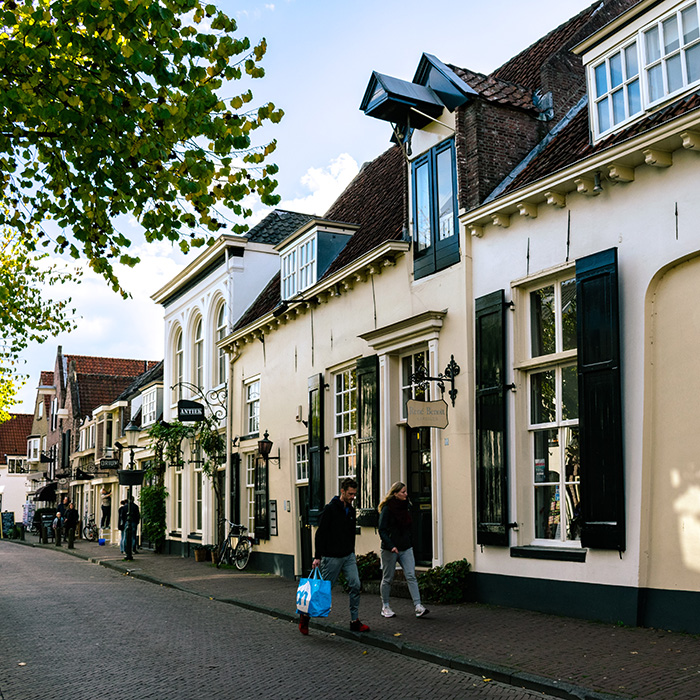 Beautiful shopping street in Amersfoort.  If you're looking for the best things to do in Amersfoort, consider browsing its many cute boutiques! #amersfoort #travel #netherlands