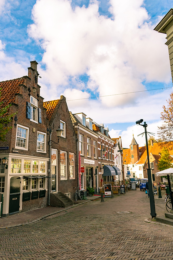 Beautiful street in Amersfoort, the Netherlands with typically Dutch houses.  Amersfoort is full of beautiful architecture! #amersfoort #netherlands #utrecht #nederland