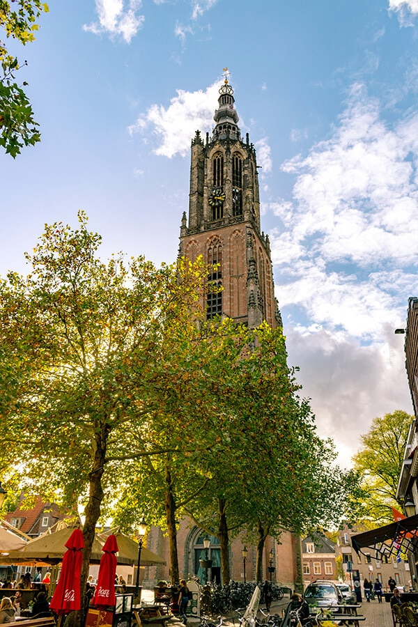 The beautiful historic Onze Lieve Vrouwetoren, one of the best attractions in Amersfoort, the Netherlands.  This beautiful day trip from Amersfoort is perfect for history lovers. #amersfoort #Netherlands #Nederland