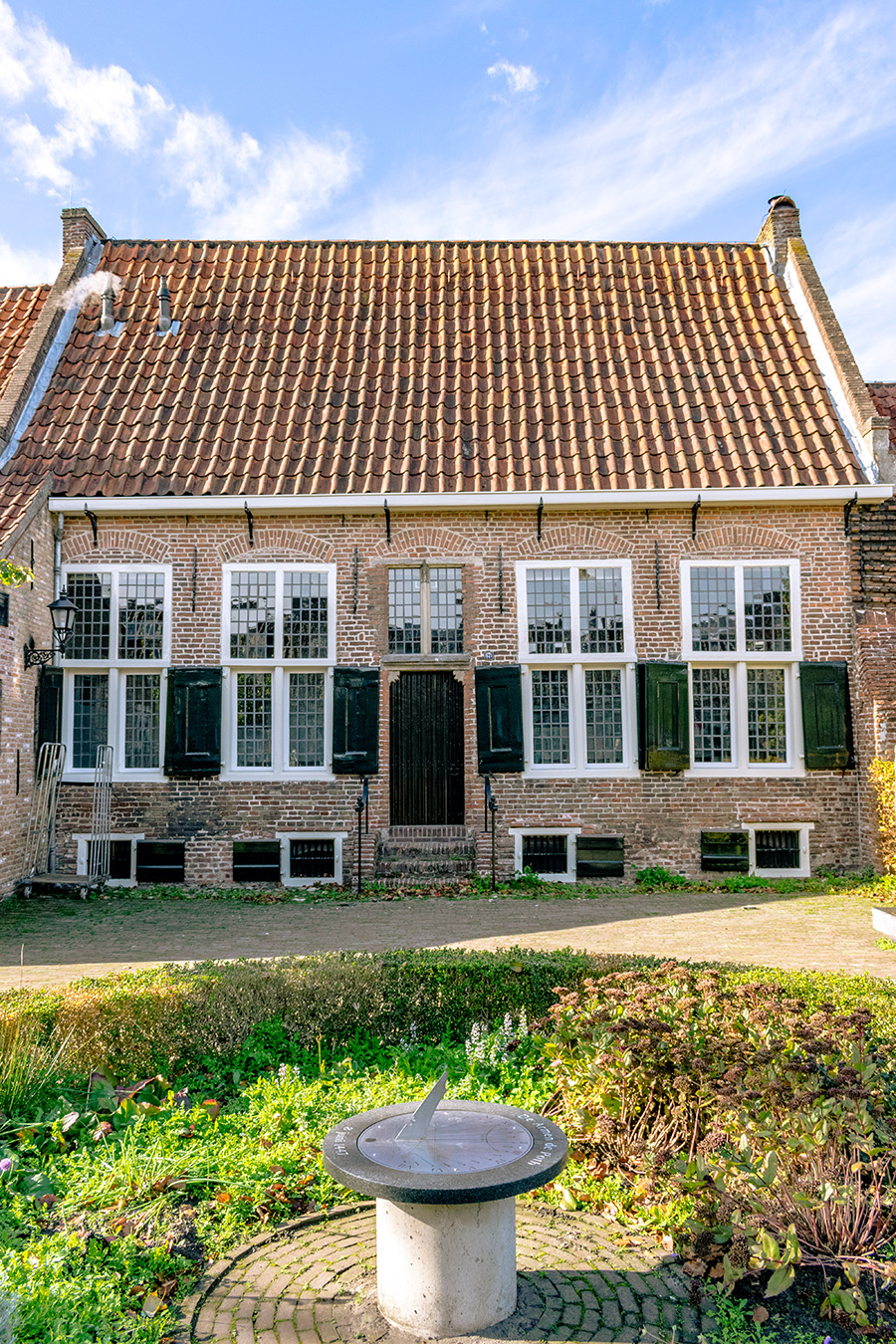 One of the beautiful houses within the courtyard, De Armen de Poth.  This hofje in Amersfoort was used to help plague victims! #hofje #nederland #amersfoort #netherlands #travel