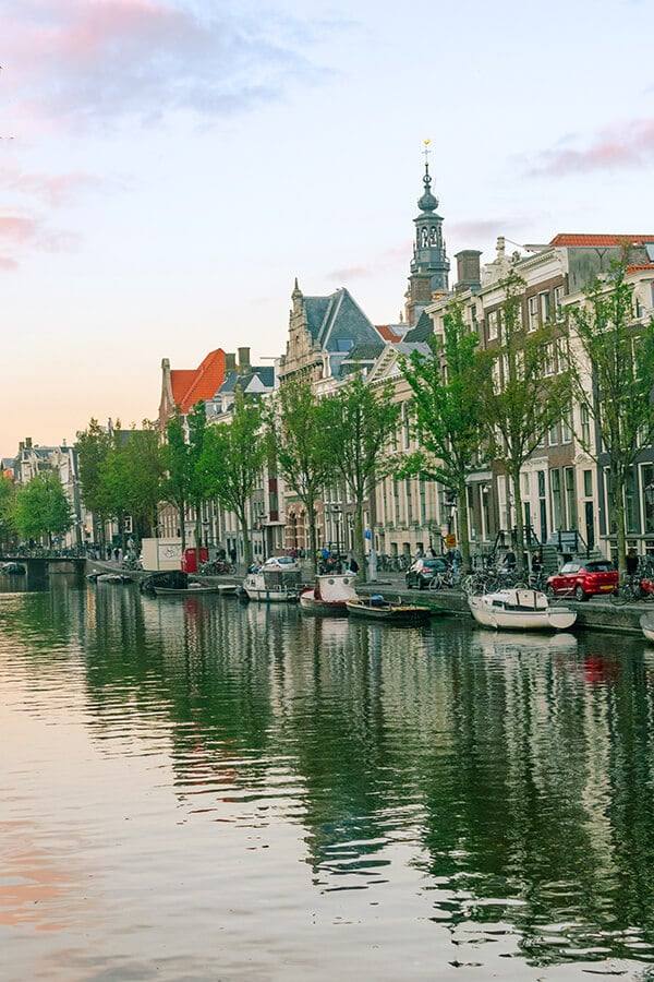 Beautiful sunset in Amsterdam; Walking along the canals is one of the best activities for couples in Amsterdam. #amsterdam #holland #netherlands