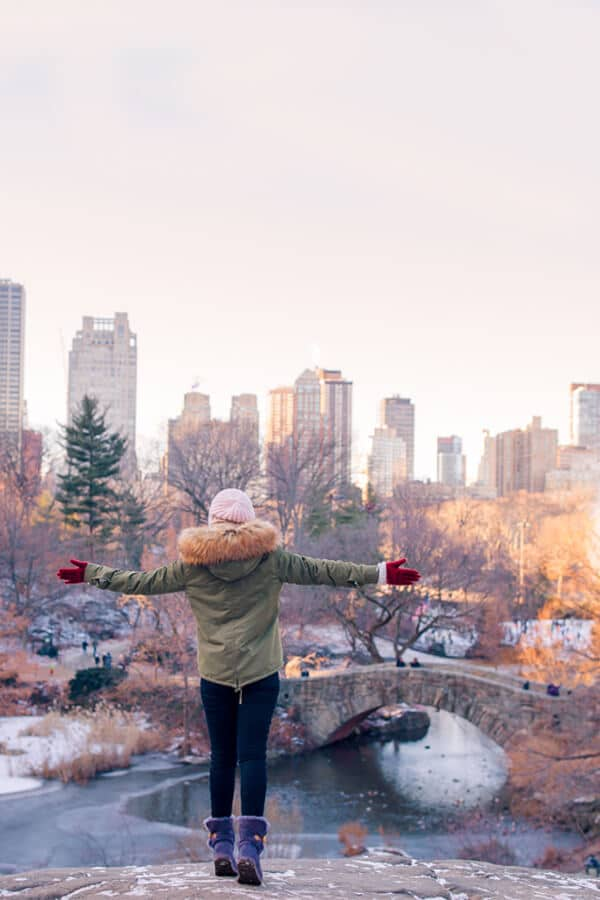 Girl admiring view of Central Park during winter in New York City.  Even if it's cold, you can still enjoy the best of New York! #travel #NYC #NewYorkCity