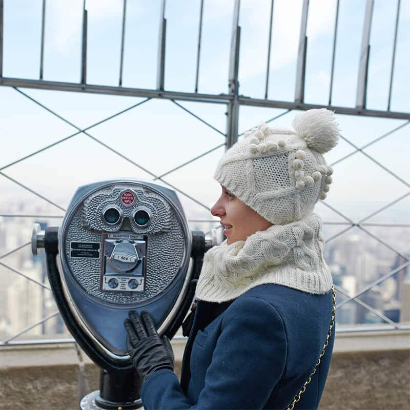 Girl admiring the view from the Empire State Building during winter in New York, one of the most magical times to visit NYC! #travel #NYC #NewYorkCity