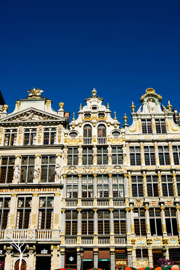 Beautiful buildings in Grote Markt (Grand Place) in Brussels.  Read why you should visit this beautiful UNESCO recognized square in Brussels! #travel #brussels #belgium #europe