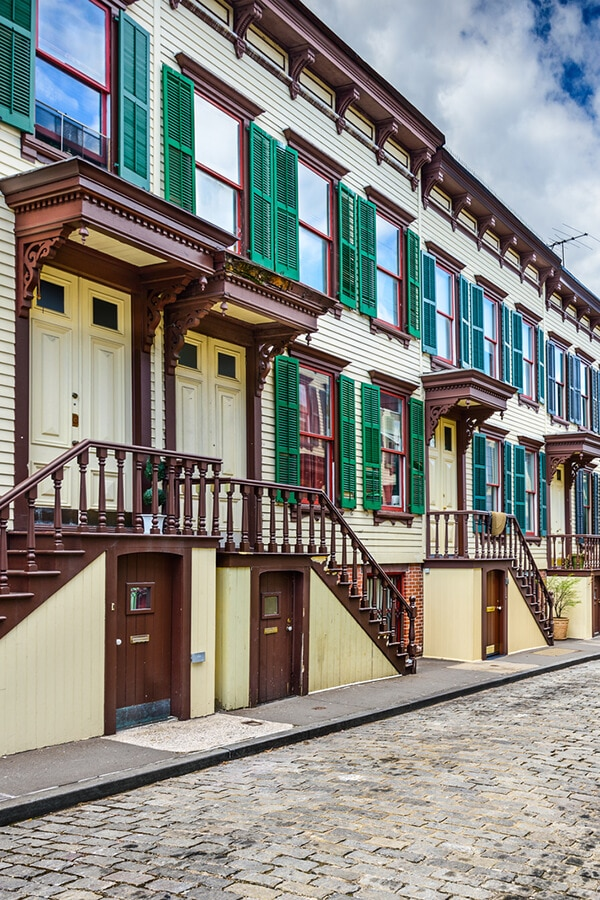 Sylvan Terrace is one of the most beautiful streets in New York City for seeing a glimpse of secret New York.  This beautiful dead-end is worth the subway trip up to Washington Heights! #manhattan #travel #NewYork #NYC #NewYorkCIty