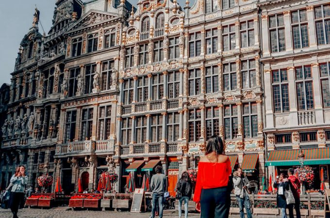 Girl walking around Grand Place in Brussels, Belgium