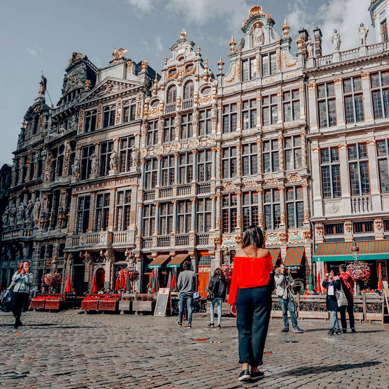 Girl walking through Grand Place in Brussels, one of the most beautiful places to visit in Europe! #belgium #brussels #travel #europe