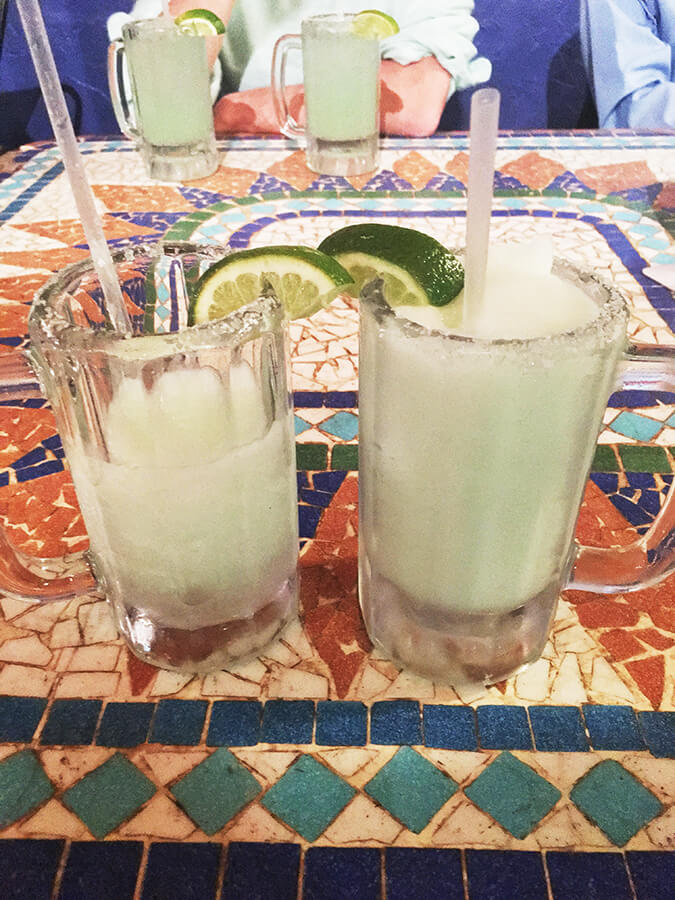 Two margaritas. Read how much you should tip at a cafe or bar in the United States as a traveler! #travel #USA