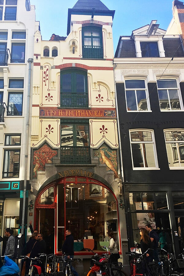 Beautiful storefront along Haarlemmerstraat in Amsterdam.  This charming shopping street is one of the most beautiful streets in Amsterdam not to miss! #travel #amsterdam #holland #netherlands