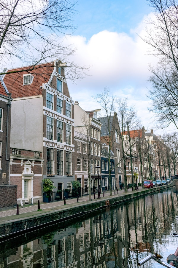 Oudezijds Achterburgwal is one of the most picturesque streets in Amsterdam.  This street at the heart of the red light district is worth seeing! #travel #holland #netherlands #amsterdam