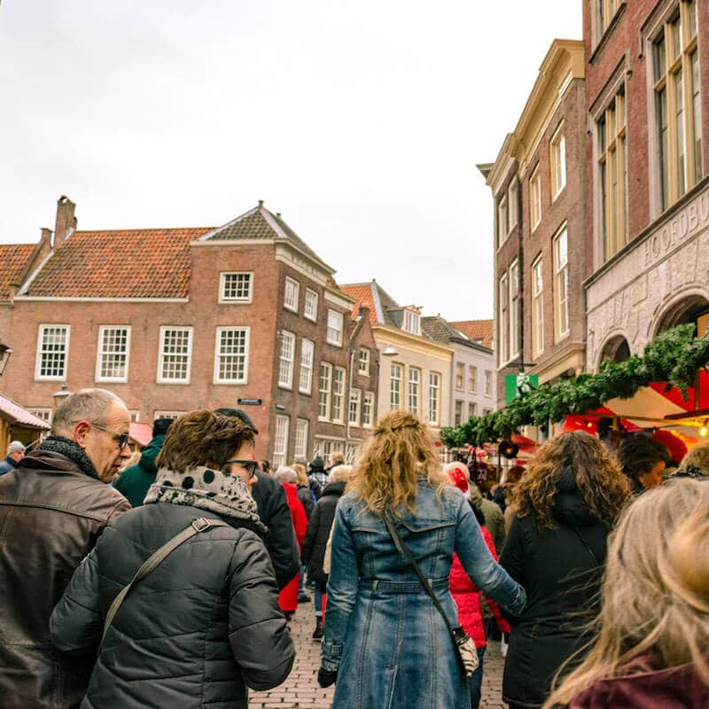 Woman shopping at the Dordrecht kerstmarkt, one of the most famous christmas markets in the Netherlands! #netherlands #holland #travel