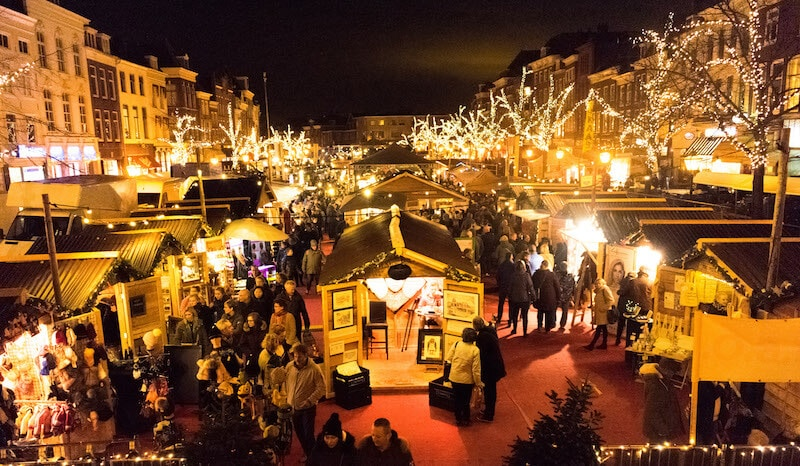The lit up floating Christmas market in Leiden during December is one of the best seasonal activities in Leiden.