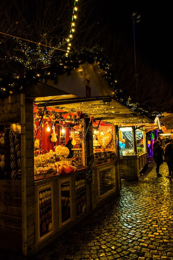 Beautiful lit-up Christmas stall at the Maastricht Christmas market, one of the best Christmas markets in the Netherlands. #netherlands #kerst #christmas #travel