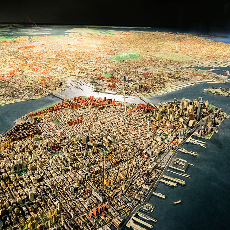 Curious about seeing New York City from above without a helicopter? Head to the Queens Museum of Art to see this miniature version of New York City that was made to scale.  This budget friendly activity in New York is perfect for families. #travel #NYC #NewYork
