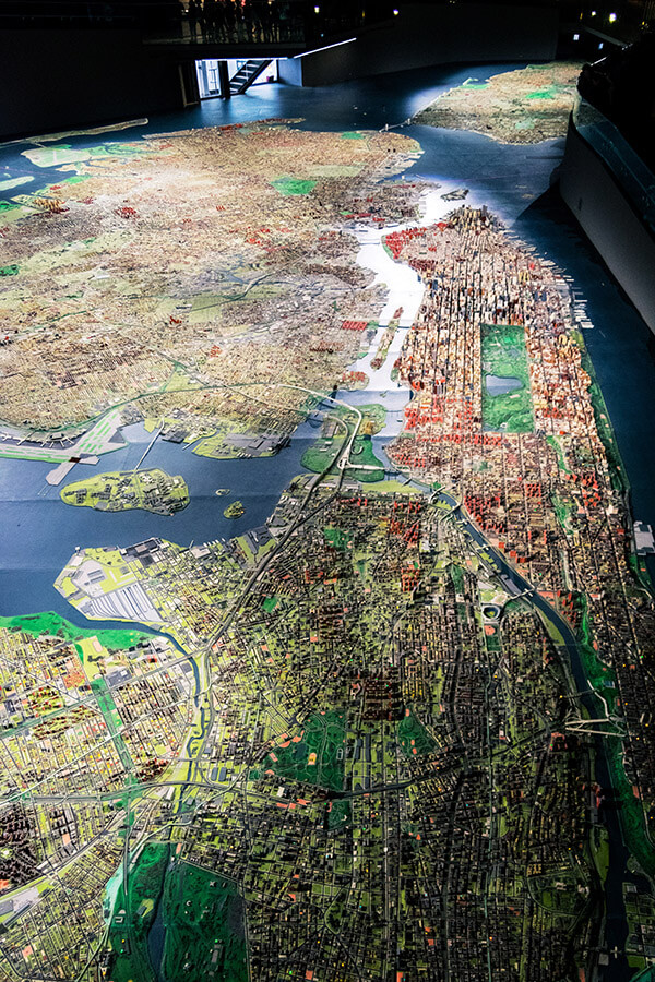 View of Manhattan and the Bronx from above at the Panorama of the City of New York.  This miniature of New York is a great family-friendly exhibition in New York City! #travel #NYC #NewYork #Manhattan