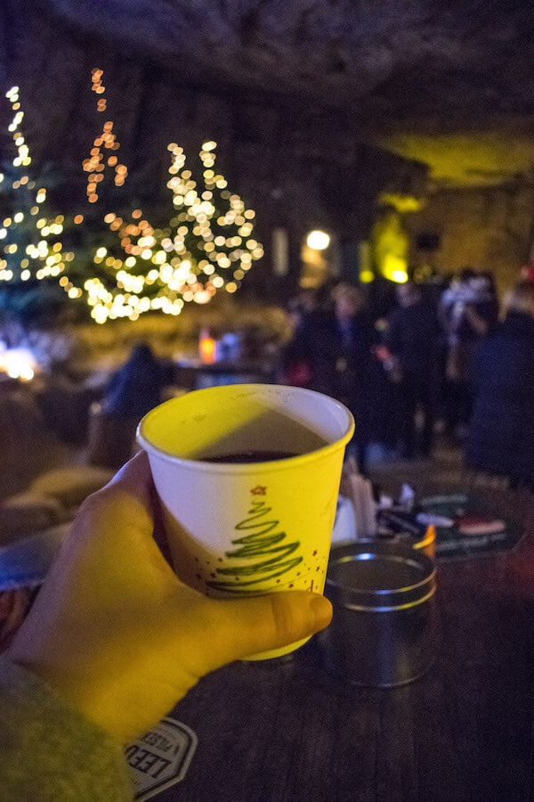 Glühwein held in the Gemeentegrot, one of the caves in Valkenburg where you can enjoy the Valkenburg Christmas Markets underground! #netherlands #valkenburg #limburg #travel #christmas #kerst