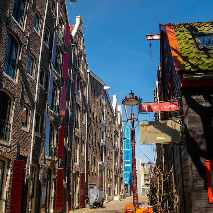 Beautiful old warehouses along Prinseneiland in Amsterdam.  This beautiful neighborhood (westelijke eilanden) in Amsterdam is worth exploring! #travel #netherlands #holland #amsterdam