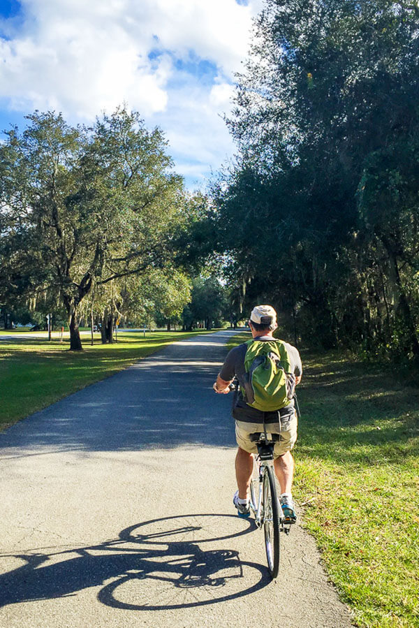 Man Cycling the Withlacoochee State Trail in Central Florida #travel #florida #cycling